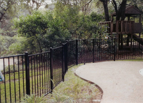 2 rail black fence around pool in backyard