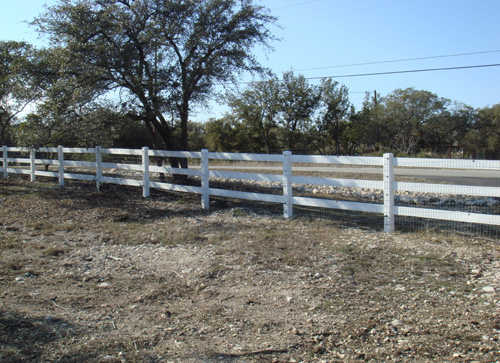 3 rail white fence around ranch