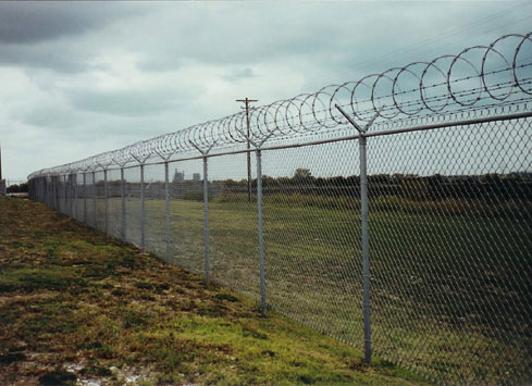 airport security chain link fence with razor wire on top