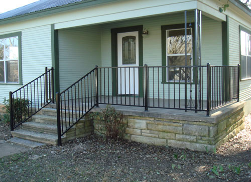 black handrail and fence around patio