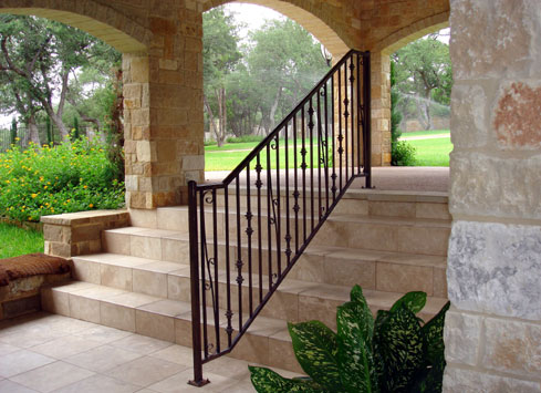black iron handrail on patio steps