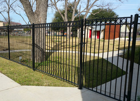 black iron metal fence with gate