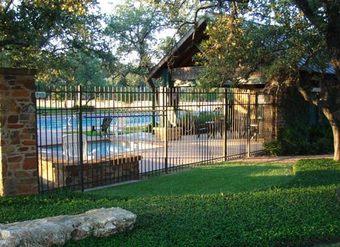 black metal security fence around pool