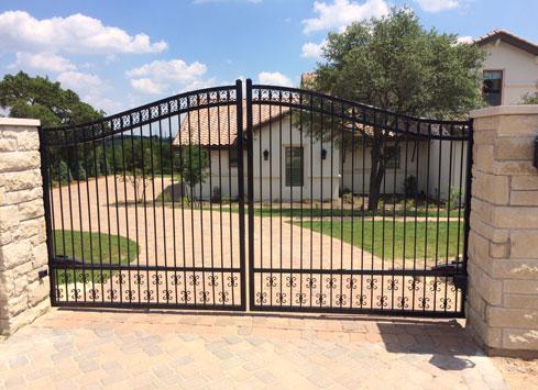 black metal swing open driveway gate