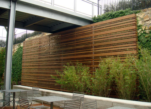 horizontal-stained-fence-under-walkway-bridge