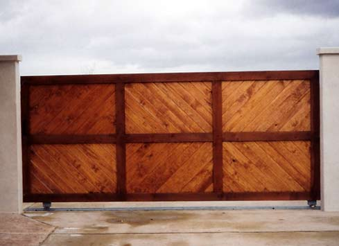 large wooden custom driveway gate