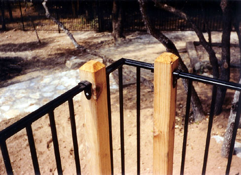 metal handrail wooden deck posts off pool 3