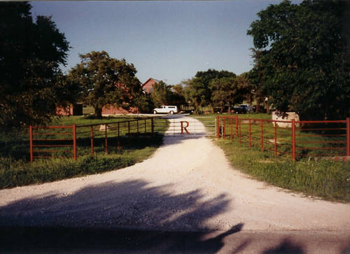 ranch fence entrance with custom gate