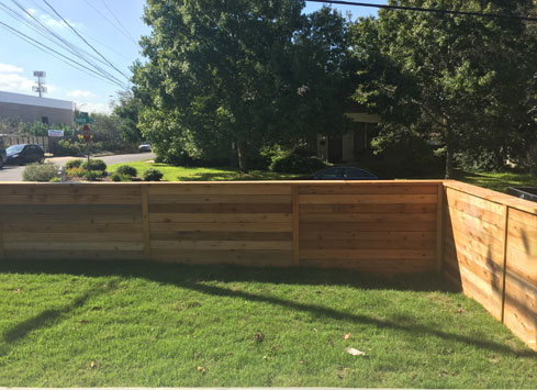 short horizontal fence around front yard