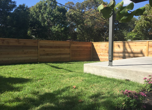 simple short horizontal fence with cap around yard