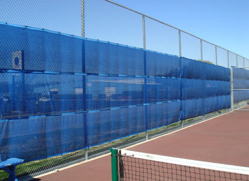 tall chain link fence with wind break tennis court
