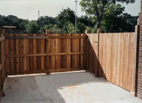 wood fence with gate at loading dock
