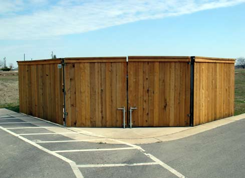 wood privacy fence around garbage dumpsters