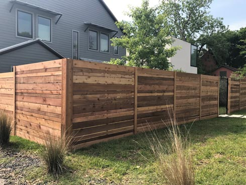 6ft-Horizontal-Semi-Privacy-Fence-with-multi-width-pickets-and-trimoutside-view