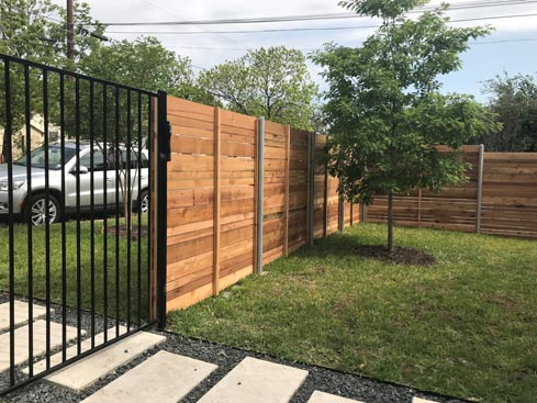6ft-Horizontal-Semi-Privacy-Fence-with-multi-width-pickets-steel-posts-and-ornamental-walk-gate.inside-view