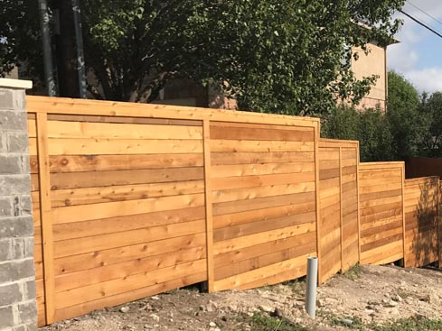 6ft-stepped-to-8ft-Tall-Horizontal-Cedar-Privacy-Fence-with-top-ledge-and-trim-boards.jpg