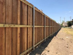 8ft Board and Baton Cedar Privacy Fence with 2x6 top ledge and 1x4 trim with Galvanized Steel Post (inside view)