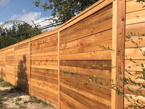 8ft Tall Horizontal Cedar Privacy Fence with top ledge and trim boards